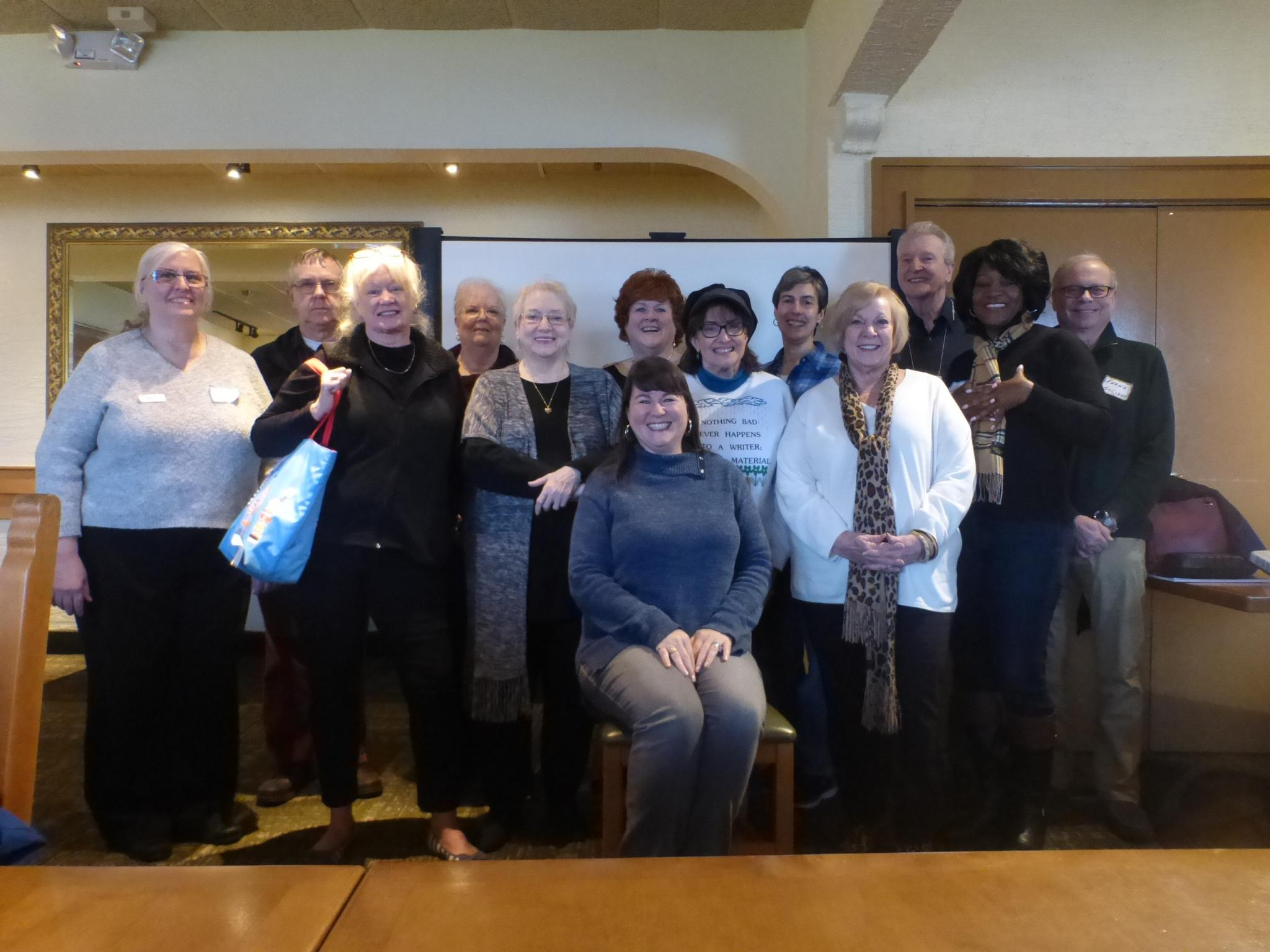 Kristine Hall, seated, was the guest speaker for the Dallas Mystery Writers group.